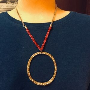 Gorgeous gold tone hammered look necklace